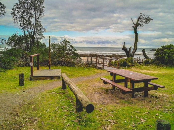 picnic table, and beach shower area with the ocean in the background at Cape Conron