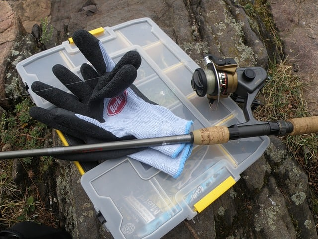You  need all the best gear when you are fishing at Lake Wellington in Gippsland. There are some gloves, a fishing tackle box and a fishing rod in this picture.