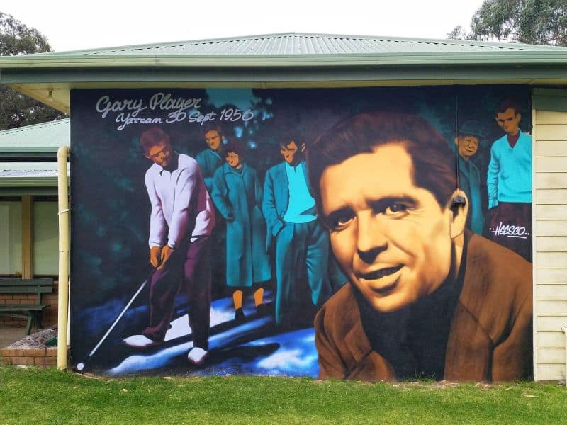 an painting of golfer gary Player on a outside wall of the Yarram Golf Course